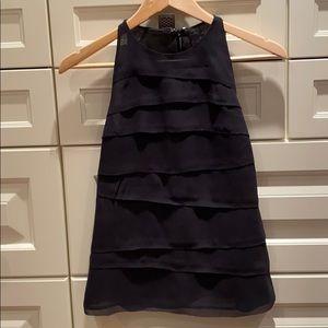 Fashionable black silk top.